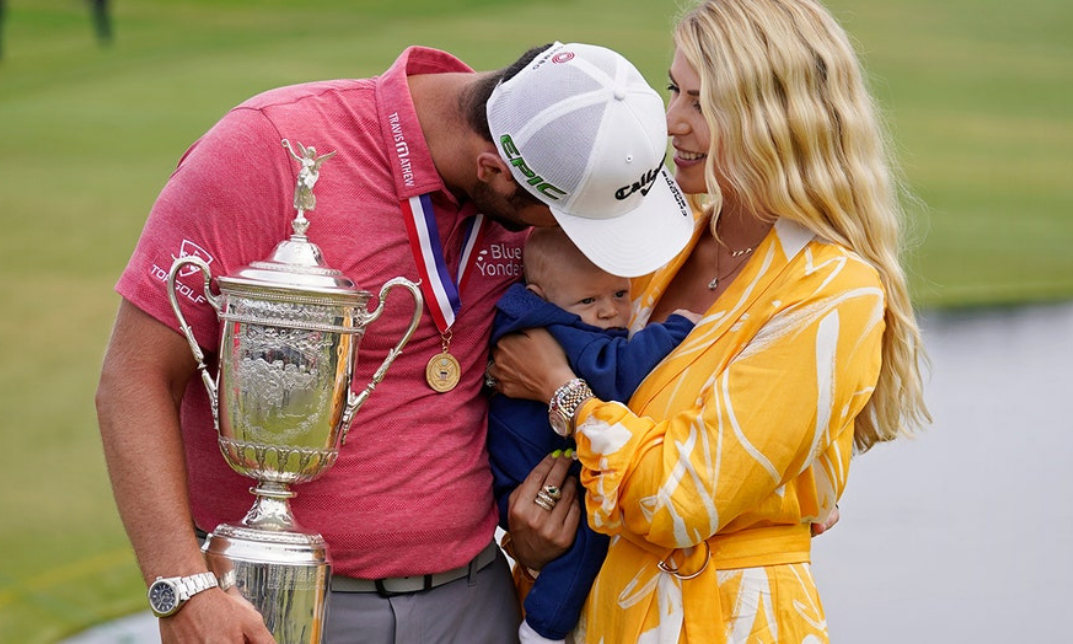 Jon Rahm hugs wife and baby son holding trophy after winning 2021 U.S. Open